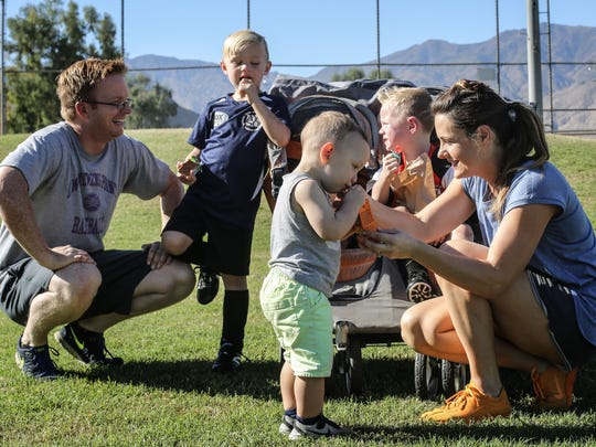 Desert Flipper TV hosts Eric and Lindsey Bennett with their children, Dean, 6, Roman, 3, and Graham, 2, at Demuth Park in Palm Springs on Saturday, October 28, 2017.