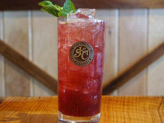 The Bluegrass Belle includes blueberry vodka and mint