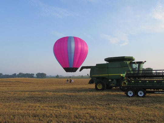 The combine was still in the field when this balloon