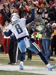 Titans quarterback Marcus Mariota (8) scores on a pass that he also caught during the second half at Arrowhead Stadium Saturday, Jan. 6, 2018 in Kansas City , Mo.