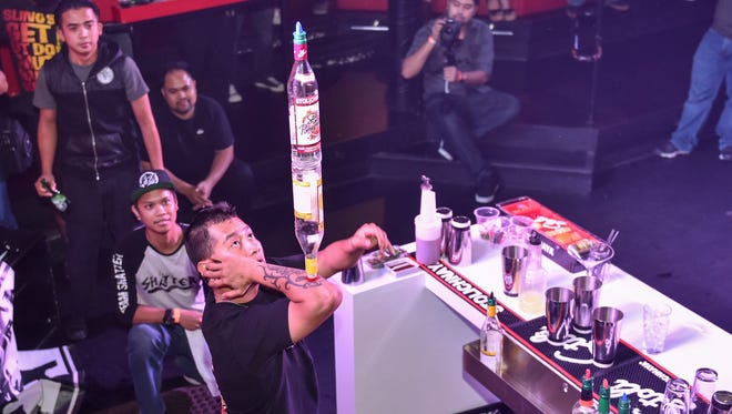 Tommy Manglona of Porky's performs at the 2015 Stoli Bartending Competition at the Globe Ultra Lounge in Tumon on Oct. 7, 2015. This year's search for top bartender will be on Aug. 3.