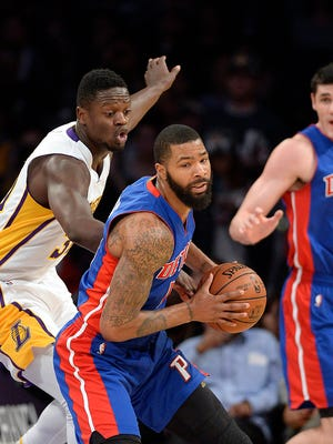 Pistons forward Marcus Morris (13) handles the ball against Lakers forward Anthony Brown (3) during the first quarter at Staples Center.
