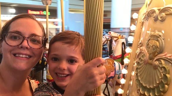 Abbey and Miles on the carousel