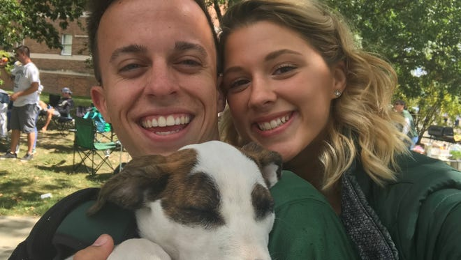 Brian Platte, Mikaela Smith and their dog, Piper, in happier times. Piper suffered deep lacerations and a spinal fracture when she was hit by a car April 20, 2018.
