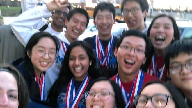 Members of Mason High School's Science Olympiad Team placed first in Ohio. They are, from left: back, Suhas Kolli, Terry Luo, Jeffrey Huang, Alex Wang and Janny Wan; middle, Jenny Hong, Ranjani Ramasubramanian, Allen Yang, Wei Gao; front, Adviser Aimee Hansen, Alyson Lam, Emily Fang.