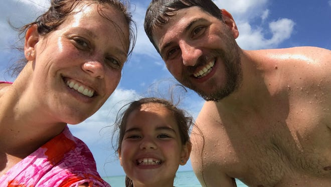 Alana Holmstrom snaps a selfie in March 2017 with her daughter Kate Wentzell and husband Devin Wentzell at one of their favorite beaches, North Gulf Shore Beach in Naples.