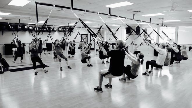 """Kelly Kanski uses TRX Suspension Training in her fitness classes at Form Fitness. """"Everything we do is body-weight strength training combined with balance, flexibility and cardio conditioning. Classes are always different — every session — recruiting multiple muscle groups in each movement. Functional, intentional, smart exercise — everything is easily modified and appropriate for all ages and stages."""""""