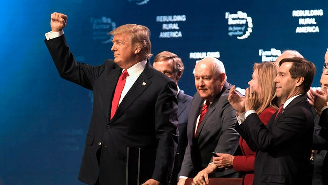 President Donald Trump says goodbye after speaking to the American Farm Bureau Federation at Gaylord Opryland Resort & Convention Center Monday, Jan. 8, 2018 in Nashville, Tenn.