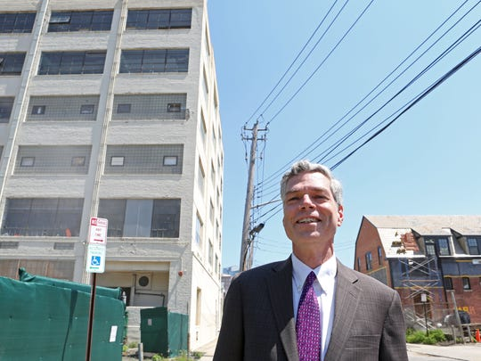 White Plains Mayor Tom Roach on Westmoreland Avenue where a former warehouse, left, is being converted into loft rentals.