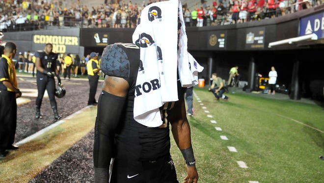 Vanderbilt's Trent Sherfield walks off the field after a 14-12 loss to Western Kentucky on Sept. 3. The Commodores will play WKU again in 2016.