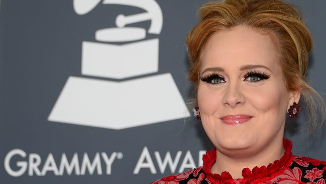File: Adele arrives on the red carpet for the 55th Grammy Awards in Los Angeles, California.