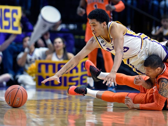 LSU guard Tremont Waters (3) dives over Auburn guard Samir Doughty (10) while going for a loose ball in the first half of an NCAA college basketball game, Saturday, Feb. 9, 2019, in Baton Rouge, La. (AP Photo/Bill Feig)