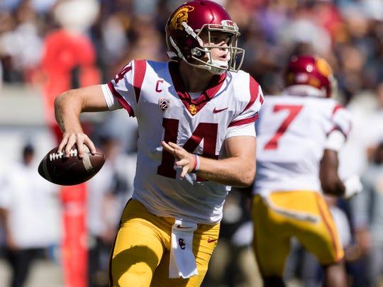 Southern California quarterback Sam Darnold runs the