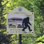 This Aug. 19 photo provided by the Kennebunk Police Department shows an graffiti on a sign in Kennebunk, Maine. Authorities have nabbed a man who's accused of spray-painting images of Sasquatch on public property in Kennebunk, Maine. Police in the picturesque coastal town didn't find the graffiti featuring Bigfoot all that amusing and charged 36-year-old Freeman Hatch with criminal mischief and possession of drugs.