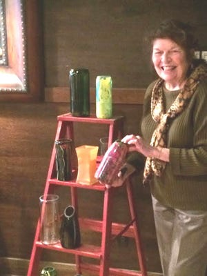 Paula Carman of Countryside Garden Club displays some of the upcycled vases that will be used for the children's arrangements during the Eco Fair on May 7.