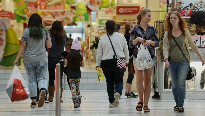 Holiday shoppers are shown last November at Pacific View mall in Ventura.