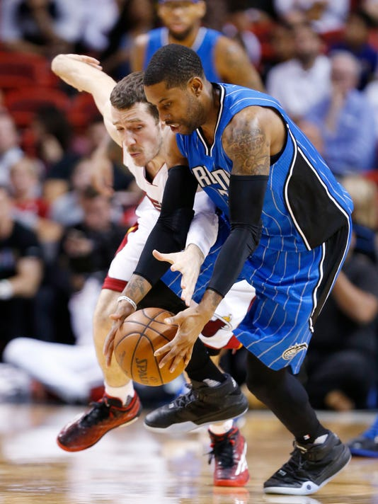 Orlando Magic guard C.J. Watson, foreground, and Miami Heat guard Goran Dragic, rear, battle for a loose ball during the first half of an NBA basketball game, Sunday, April 10, 2016, in Miami. (AP Photo/Wilfredo Lee)