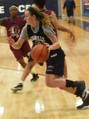 Granville senior Natalie Houser drives to the basket during a scrimmage against Linden-McKinley.