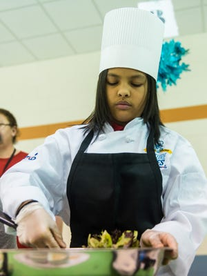 Kaitlynn Carpenter prepares a salad during Vineland's Junior Chef competition on Wednesday, March 22 at Wallace Intermediate School.
