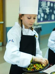 Isabella Saltar prepares a salad during Vineland's Junior Chef competition on Wednesday, March 22 at Wallace Intermediate School.