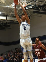 Zanesville's Cameron Brooks-Harris pulls down a rebound against Newark on Saturday at Winland Memorial Gymnasium. Brooks-Harris scored 17 points in the Blue Devils' 65-56 loss.