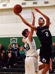 Cameron Brooks-Harris goes up for a shot over Canton Central Catholic's Brian Shepard during the Blue Devils' 53-42 win on Saturday night in Perry Township.