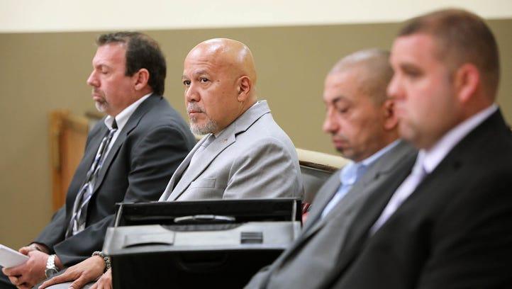 "Paterson Mayor, Jose ""Joey"" Torres sits between his"