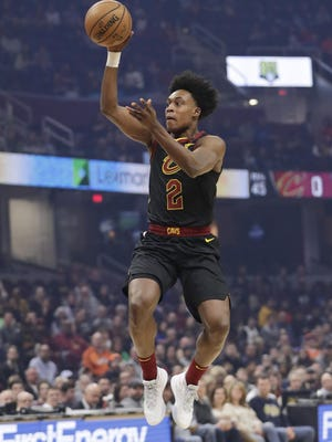 The Cavaliers' Collin Sexton shoots against the San Antonio Spurs in a game in March in Cleveland.