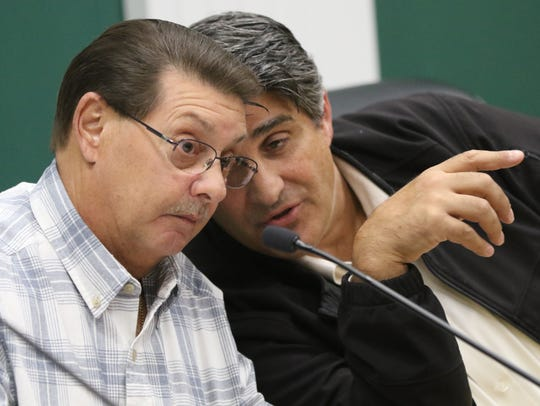 James Clark and Mayor Richard Rigoglioso of the City of Garfield Planning Board are shown during the meeting at city hall on Thursday.