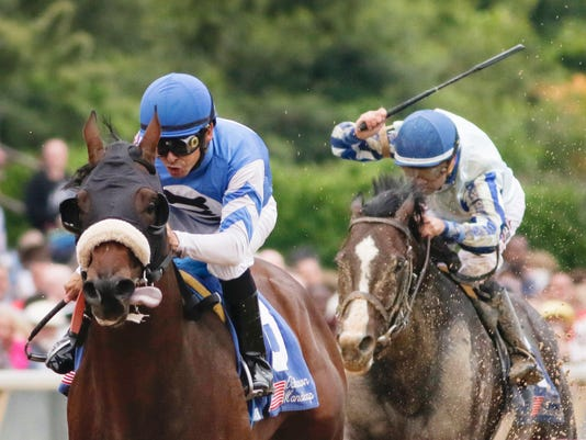 Effinex and jockey Mike Smith, left, lead Upstart and jockey Joe Bravo, right, and the rest of the field down the stretch in the Oaklawn Handicap horse race at Oaklawn Park in Hot Springs, Ark., Saturday, April 16, 2016. Effinex won the race. (AP Photo/Danny Johnston)