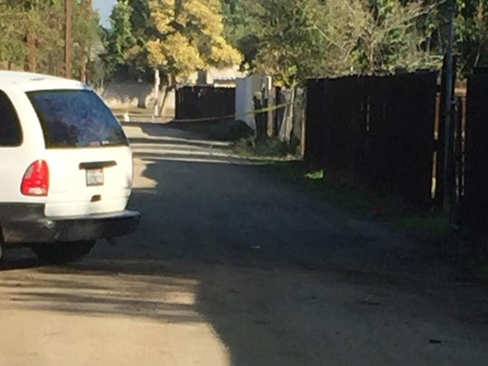 A van turns into a driveway off the alley west of North Sacramento Street and off West San Joaquin Avenue Saturday morning. Police said a 21-year-old man was fatally stabbed Friday afternoon and two teens were arrested.