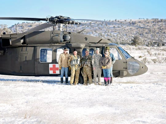 The Sisk family is seen here with the crew of a Black Hawk helicopter based out of Santa Fe.