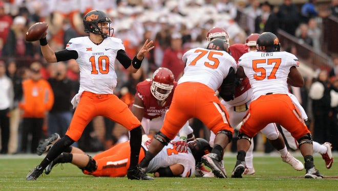 Oklahoma State Cowboys quarterback Mason Rudolph (10) throws a pass against the Oklahoma Sooners during the first quarter  at Gaylord Family - Oklahoma Memorial Stadium in Norman, Okla., on Dec. 6.