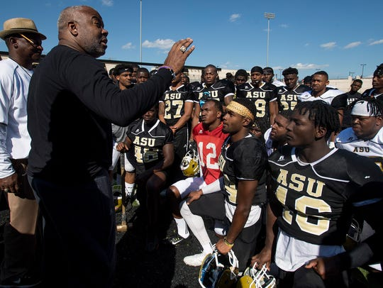 ASU President Quinton Ross talks with the team following