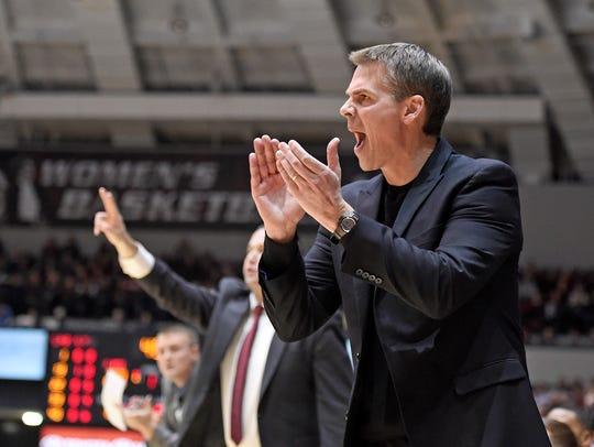 Missouri State head coach Paul Lusk encourages his