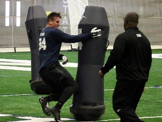 Harrisburg defensive end Evan Schwan runs a Pro Day