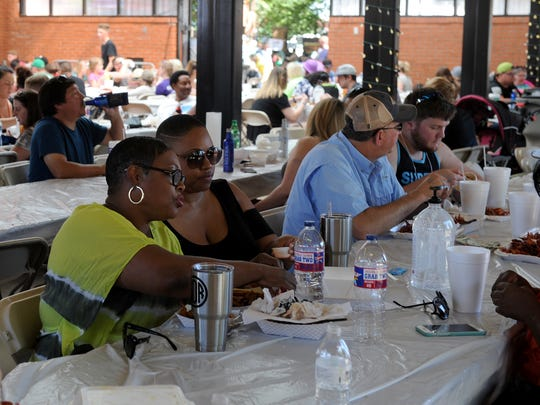 Attendees dig into their plates of crayfish at the