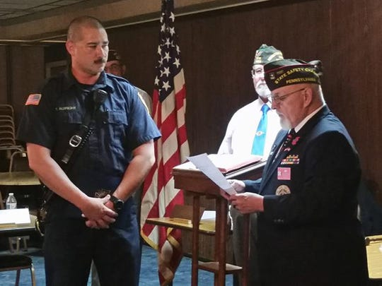 Chambersburg VFW Post 1599, Firefighter Tony E. Albright, left,  was recognized by Post Commander Tom Holden as the recipient of this year's District Firefighter of the year in April. Albright later went on to win national firefighter of the year honors.