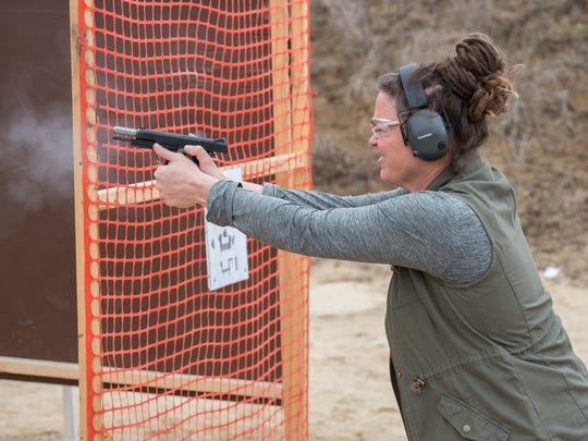 Kim Duko of Ellendale fires her pistol during an International Defensive Pistol Association match at the Bridgeville Rifle & Pistol Club. This variety of shooting match simulates self-defense scenarios and real-life encounters.