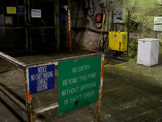Caution signs abound at the hoist entrance of the underground