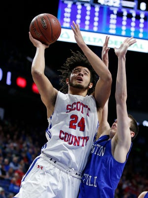 Scott County's Michael Moreno, 24, shoots against Covington Catholic's C.J. Fredrick, 1, during the championship game of the Whitaker Bank/KHSAA Boys' Sweet 16 basketball tournament played at Rupp Arena in Lexington, Ky. Sunday March 18, 2018.