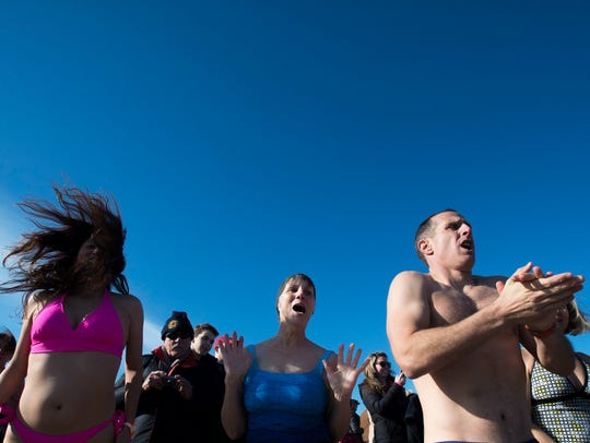 People hype themselves up before taking a plunge as the 19th annual Leo Brady Exercise like the Eskimos Plunge ensues Thursday, Jan. 1, 2015 in Bethany Beach.