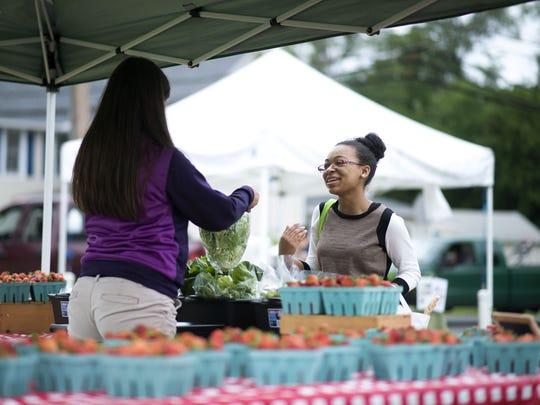 Michelle Rideau of Georgetown buys butterhead lettuce