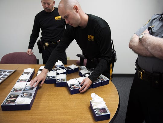 Lt. Nick Moore organizes the cards Thursday, July 14