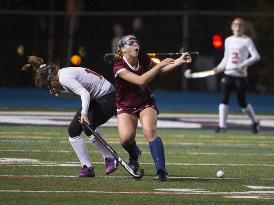 Eastern's Sarah Iannuzzi, right, loses her stick against West Essex during the NJSIAA Tournament of Champions Final Friday at Kean University in Union. Eastern lost 2-1 in overtime.