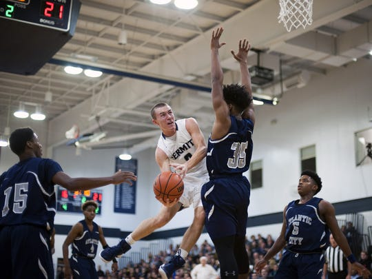 Austin Kennedy of St. Augustine goes up for a shot past Atlantic City's Zion Monague during action in Saturday's CAL game.