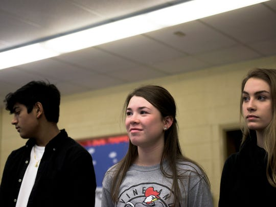 Student Marianne Burgess, 16, center, stands among