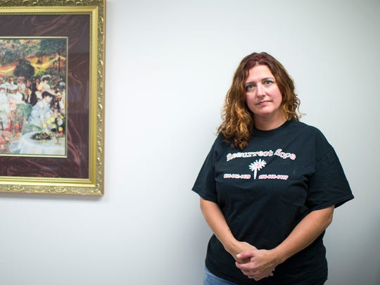 Kelly Sottile, a recovery coach who is in recovery from a heroin addition, poses inside Inspira Woodbury.
