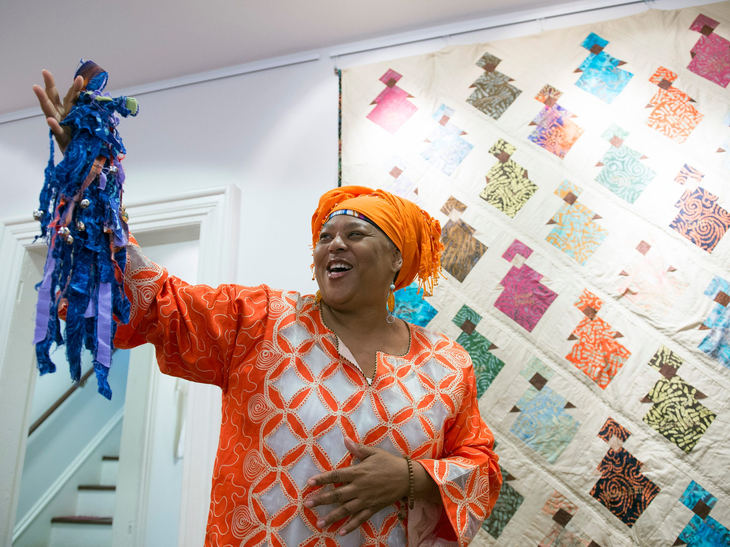 Karen 'Queen Nur' Abdul-Malik displays one of the dolls inside the Dolls of Distinction Exhibition at the Smithville Mansion in Eastampton recently. Queen Nur is a storyteller and teaching artist, who resides in Willingboro. She is also the director of the Folklife Center at Perkins Center for the Arts.