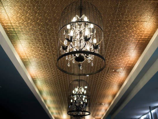 A chandelier is suspended inside Maison 208 in Philadelphia.
